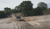 Watch as flood sweeps vehicle off bridge in Zimbabwe